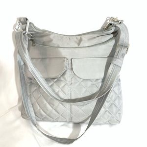 TRAVELON ANTI THEFT COMPLETE SILVER CROSSBODY BAG